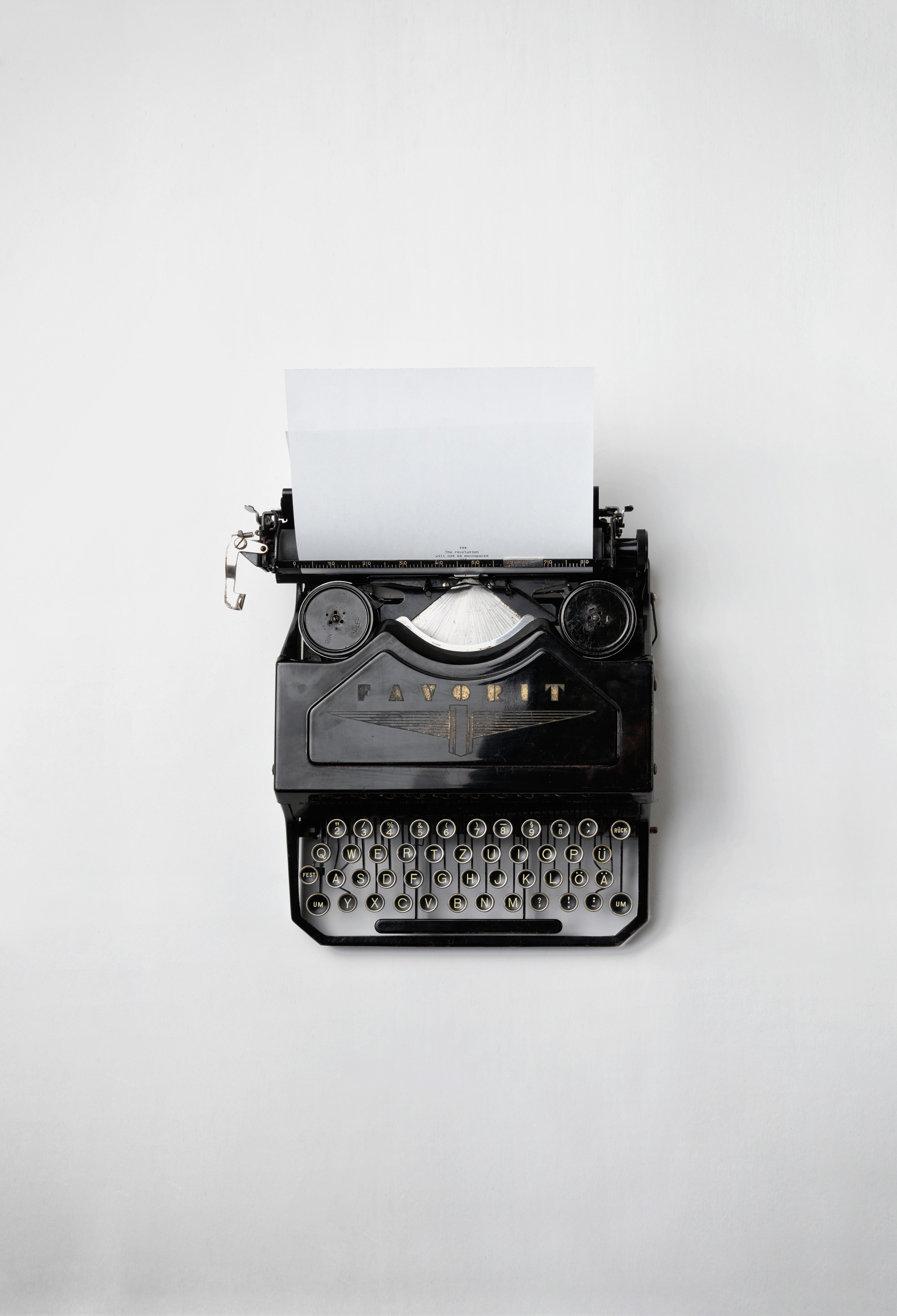 old black typewriter with paper jpeg