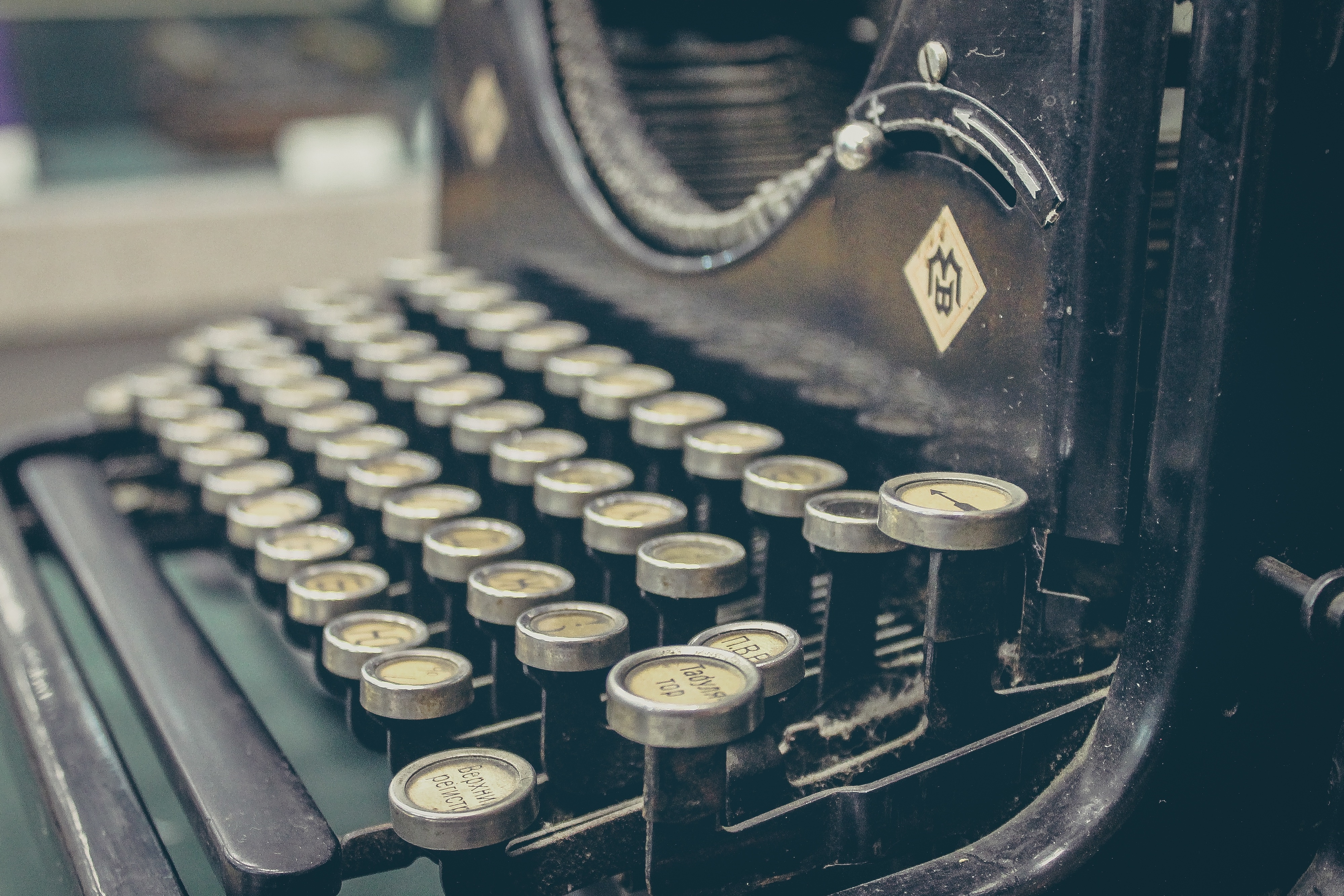 old black typewriter with paper jpg