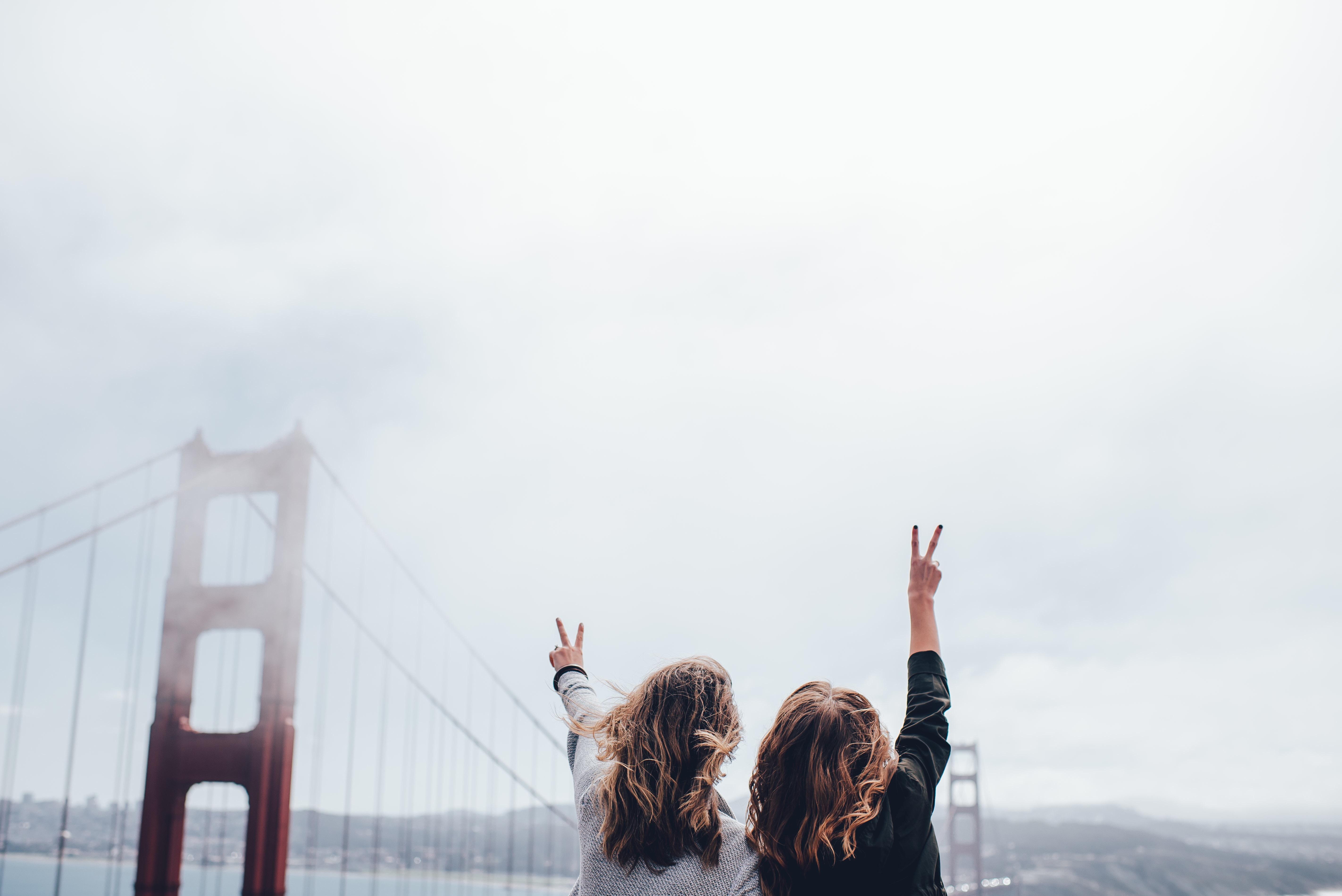 san fran bridge two girls peace sign jpeg